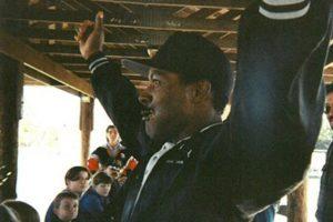 Rudy King with hands raised