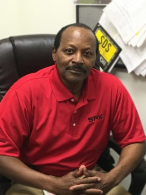Rudy King in office chair