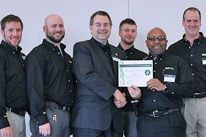 Green Masters Distinction award being accepted by SPX Team