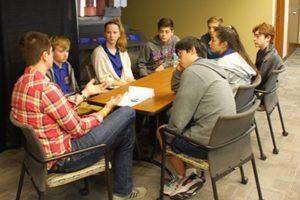 Tim Roque teaching in community outreach program